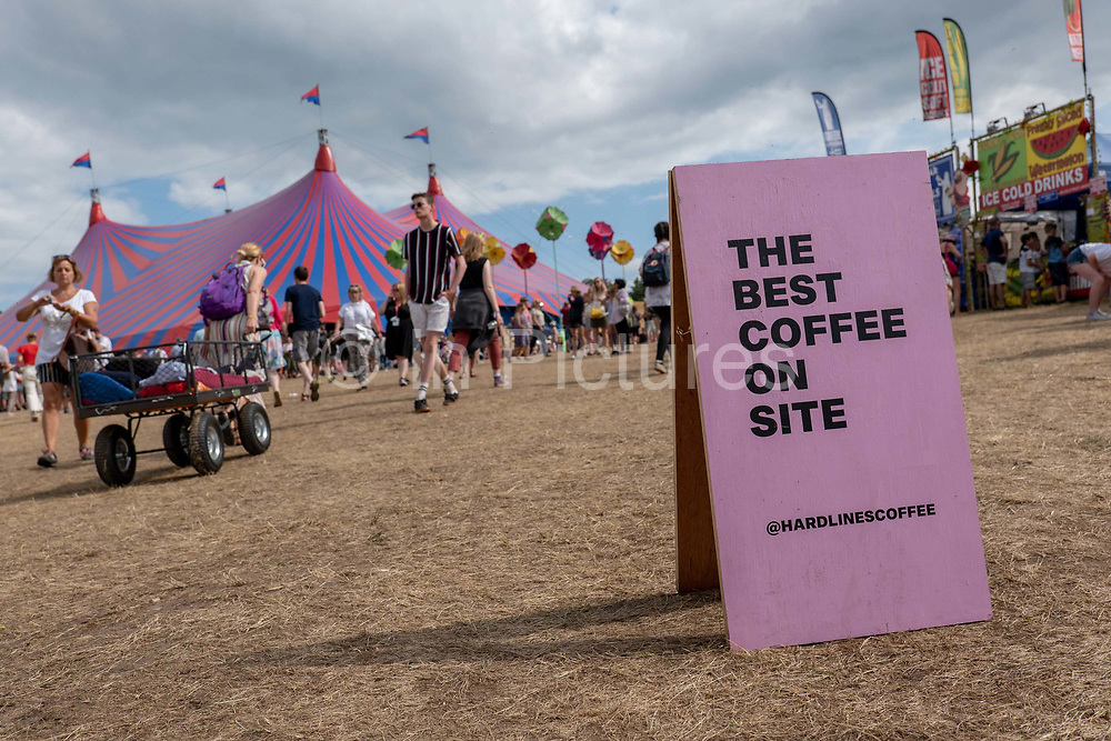 A food and drinks sign with the words The Best Coffee on Site during the Latitude Festival on the 21st July 2019 in Southwold in the United Kingdom.