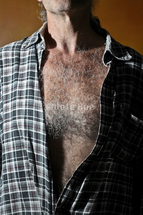 male person with open shirt showing his hairy breast