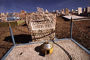 Tombstone with small tin model of a ger, (a rounded Mongol home) in Ulaanbaatar, Mongolia.