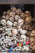 Skulls and bones kept in a glass-covered cabin shrine in a Killing Cave of Phnom Sampeau in Battambang region, Cambodia, South East Asia.  These are some of the people who were butchered to death by the Khmer Rouge Regime in the 1970s and their bodies were thrown into caves.  (photo by Andrew Aitchison / In pictures via Getty Images)