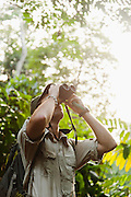 Man with binoculars, Odzala-Kokoua National Park.