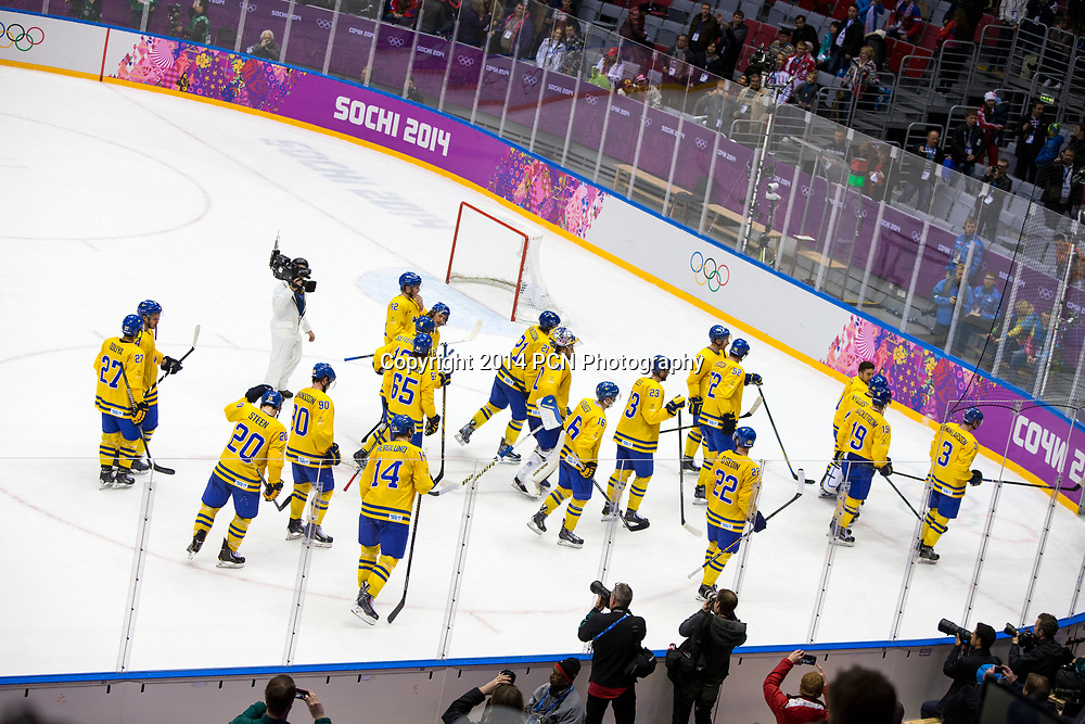 Team Sweden celebrates during Sweden vs Slovenia game at the Olympic Winter Games, Sochi 2014