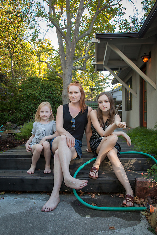 Pyrography artist Amy Boulant and her daughters, Scarlett (13) and Tallulah (6) have volunteered to water a neighbor's garden.  amyboulant@sbglobal.net
