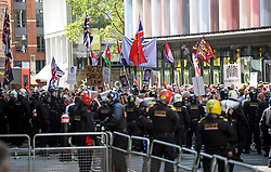 © Licensed to London News Pictures. 11/07/2019. London, UK. Large numbers of police watch over supporters of activist Stephen Yaxley-Lennon Known as Tommy Robinson, outside The Old Bailey in London after he was jailed for nine months. The former leader of the English Defence League (EDL) is being sentenced for contempt of court for filming defendants at a trial at Leeds Crown Court and broadcast the video on social media. Photo credit: Ben Cawthra/LNP
