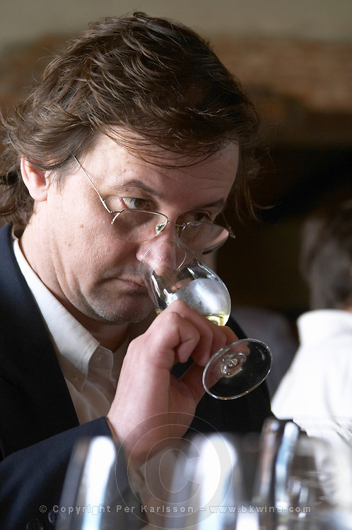 Jose Lez, oenologist and winery manager, in the tasting room tasting a glass of white wine, the oenologist and wine maker. Bodega Juanico Familia Deicas Winery, Juanico, Canelones, Uruguay, South America
