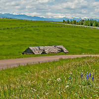 Fair weather cumulus clouds drift over pastures in Montana's Gallatin Valley, near Bozeman.  The Spanish Peaks (R) and Tobacco Root Mountains (L) rise in the background.