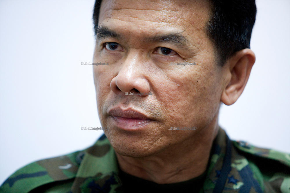 Media Spokesman of the Thai army in the southern provinces of Thailand Acra Tiproch in his office in Yala. Thailand is struggling to keep up appearances as the land of smiles has to face up to its troubled south. Since 2004 more than 3500 people have been killed and 4000 wounded in a war we never hear about. In the early hours of January 4th 2004 more than 50 armed men stormed a army weapons depot in Narathiwat taking assault rifles, machine guns, rocket launchers, pistols, rocket-propelled grenades and other ammunition. Arsonists simultaneously attacked 20 schools and three police posts elsewhere in Narathiwat. The raid marked the start of the deadliest period of armed conflict in the century-long insurgency. Despite some 30,000 Thai troops being deployed in the region, the shootings, grenade attacks and car bombings happen almost daily, with 90 per cent of those killed being civilians. 17.09.2007. Photo: Christopher Olssøn