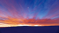 Moon over White Sands National Monument at Dawn. Image taken with a Nikon D4 and 24 mm f/1.4G lens (ISO 400, 24 mm, f/1.4, 1.3 sec).