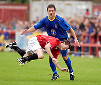 Picture by Daniel Hambury.<br /> 23/07/05.<br /> AFC wimbledon v Football Club United of Manchester. Pre season friendly.<br /> FC United's Dave Sargent is fouled by AFC Wimbledon's Ricci Crace.