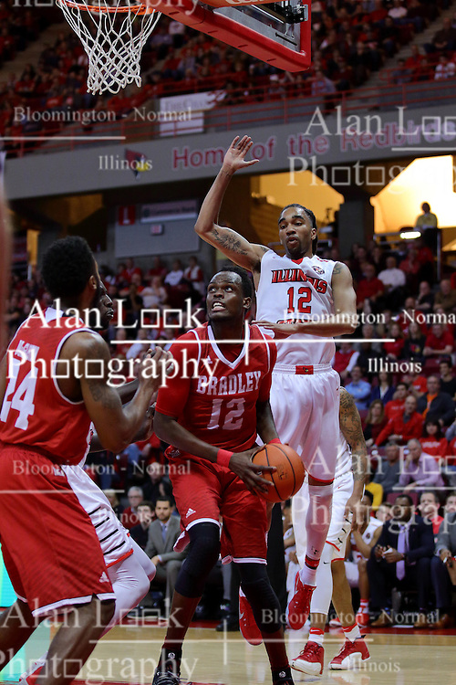 "11 February 2017:  Koch Bar hesitates to try and fake out Daouda ""David"" Ndiaye (4) and Tony Wills(12) during a College MVC (Missouri Valley conference) mens basketball game between the Bradley Braves and Illinois State Redbirds in  Redbird Arena, Normal IL"