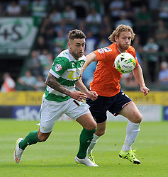 Jack Compton of Yeovil Town is tackled by Craig Mackail-Smith of Luton Town - Photo mandatory by-line: Harry Trump/JMP - Mobile: 07966 386802 - 22/08/15 - SPORT - FOOTBALL - Sky Bet League Two - Yeovil Town v Luton Town - Huish Park, Yeovil, England.