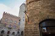 Scenic narrow street of small medieval town of San Gimignano ,Tuscany, Italy