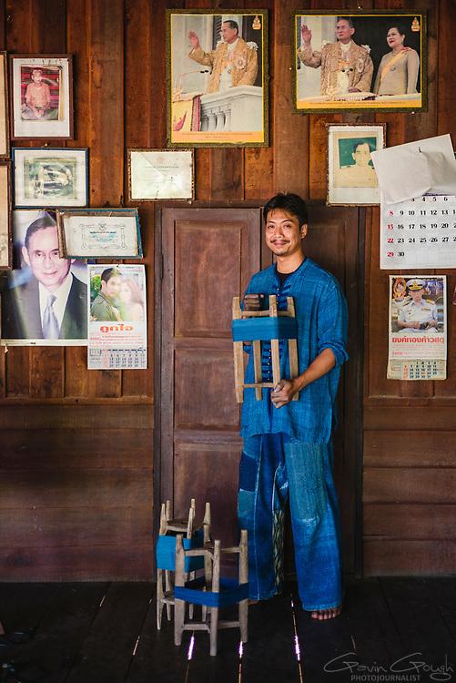 An indigo farmer holding yarn dyed with indigo, Indigo Dyeing Factory, Sakhon Nokhon, Thailand