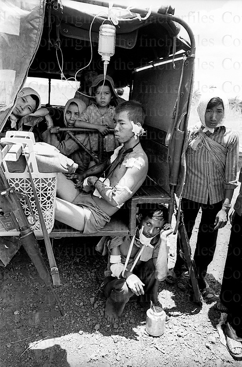 Wounded soldiers and civilians. Evacuations near Xuan Loc in South Vietnam as the North Vietnamese army made their advance on the city. Xuan Loc was the last major battle of the Vietnam War fought between 9th and 21st April 1975. Photographed by  Terry Fincher.