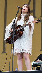 © Licensed to London News Pictures. 14/06/2015. Isle of Wight, UK.   First Aid Kit performing live at Isle of Wight Festival 2015, Day 4 Sunday.   In this picture - Klara Soderberg.  Headline acts include The Prodigy, Blur and Fleetwood Mac.   Photo credit : Richard Isaac/LNP