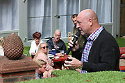 Liverpool legend Steve McMahon entertains the fans as they celebrate outside the stadium and through the city before and during the Premier League match between Liverpool and Aston Villa at Anfield, Liverpool, England on 5 July 2020.