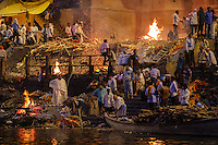 VARANASI, INDIA - CIRCA NOVEMBER 2016: Cremation in progess at the Manikarnika Ghat. This is is one of the oldest ghats in Varanasi, and most known for beign the primary place for Hindu cremations. The city of Varanasi is the spiritual capital of India, it is the holiest of the seven sacred cities in Hinduism and Jainism.