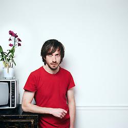 Paris, France. December 9, 2015. Thomas Blanchard, actor, posing in an apartment. Photo: Antoine Doyen