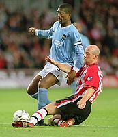 Sylvain Distin (City) Chris Marsden (Southampton). Southampton v Manchester City. 1/11/2003. Credit : Colorsport/Andrew Cowie.