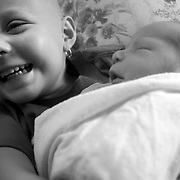 A sibling meeting their younger sibling for the first time is one of the most important moments of a family's life. This collection of images captures the first two meetings of Larue, 3 and her brother Rory.