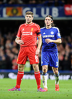 Liverpool's Steven Gerrard and Chelsea's Filipe Luis<br /> <br /> Photographer Ashley Western /CameraSport<br /> <br /> Football - Capital One Cup Semi Final Second Leg - Chelsea v Liverpool - Tuesday 27th January 2015 - Stamford Bridge - London<br /> <br /> © CameraSport - 43 Linden Ave. Countesthorpe. Leicester. England. LE8 5PG - Tel: +44 (0) 116 277 4147 - admin@camerasport.com - www.camerasport.com