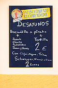 Menu tariff for dish of the day bocadillo sandwiches and pincho tortilla at bar restaurant Montanes in Plaza de Santo Martino in Leon, Spain