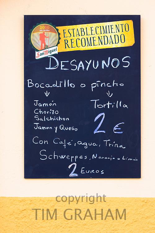 Menu tariff for dish of the day bocadillo sandwiches and pincho tortilla at bar restaurant Montanes in Plaza de Santo Martino in Leon, Spain