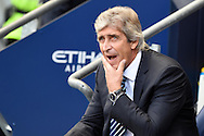 Manchester city manager Manuel Pellegrini looks on before the match. Barclays premier league match, Manchester city v Chelsea at the Etihad stadium in Manchester,Lancs on Sunday 21st Sept 2014<br /> pic by Andrew Orchard, Andrew Orchard sports photography.