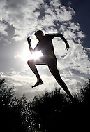PERTH, AUSTRALIA - JUNE 13: Aaron Scott runs at City Beach on June 13, 2012 in Perth, Australia. (Photo by Paul Kane)