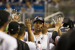 July 17, 2017 - USA - Marlins outfielder Giancarlo Stanton celebrates with teammates after blasting a home run in the first inning as the Miami Marlins play the Philadelphia Phillies at Marlins Park on Monday, July 17, 2017 in Miami. (Credit Image: © Bryan Cereijo/TNS via ZUMA Wire)