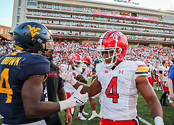 Sep 4, 2021; College Park, Maryland, USA; Maryland Terrapins running back Isaiah Jacobs (4) talks with West Virginia Mountaineers running back Leddie Brown (4) after the game at Capital One Field at Maryland Stadium. Mandatory Credit: Ben Queen-USA TODAY Sports