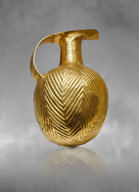 Bronze Age Hattian gold flask from a possible Bronze Age Royal grave (2500 BC to 2250 BC) - Alacahoyuk - Museum of Anatolian Civilisations, Ankara, Turkey .<br /> <br /> If you prefer to buy from our ALAMY PHOTO LIBRARY  Collection visit : https://www.alamy.com/portfolio/paul-williams-funkystock/royal-tombs-alaca-hoyuk-bronze-age.html (TIP refine search by adding background colour in the LOWER search box)<br /> <br /> Visit our ANCIENT WORLD PHOTO COLLECTIONS for more photos to download or buy as wall art prints https://funkystock.photoshelter.com/gallery-collection/Ancient-World-Art-Antiquities-Historic-Sites-Pictures-Images-of/C00006u26yqSkDOM