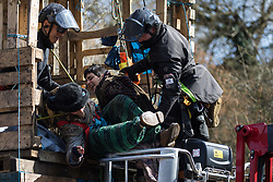 Denham, UK. 22nd March, 2021. Bailiffs from the National Eviction Team (NET) remove activists opposed to the HS2 high-speed rail link from a makeshift tower in Denham Country Park where they had been seeking to delay electricity pylon relocation works by Babcock in connection with the project.
