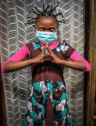 May 2, 2020, Nairobi, Kenya: 12 year old, Martha Apisa is seen using her hair style braids to create awareness and sensation about the Corona Virus during the pandemic..Daily life in Kibera slums the largest in Nairobi, has not been greatly affected by the ongoing covid19 pandemic except for a few activities limited by the imposed curfew due to the pandemic. (Credit Image: © Donwilson Odhiambo/SOPA Images via ZUMA Wire)