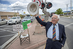 April 26, 2017 - Santa Fe, New Mexico, U.S. - FABIO MACCHIONI, from Santa Fe, waves to motorists from the median at the intersection of Cerrillos Road and St. Francis Drive in Santa Fe, Wednesday. Macchioni was there protesting against the soda tax to fund Pre-K for some children.  City leaders pushed soda tax to fund early childhood education. (Credit Image: © Eddie Moore/Albuquerque Journal via ZUMA Wire)