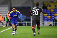 AFC Wimbledon defender Terell Thomas (6) battles for possession with Lincoln City midfielder Brennan Johnson (20) during the EFL Sky Bet League 1 match between AFC Wimbledon and Lincoln City at Plough Lane, London, United Kingdom on 2 January 2021.