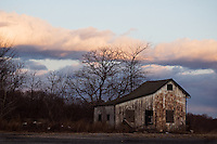 An abandoned old wooded building sits decaying in rural Salem County, NJ.