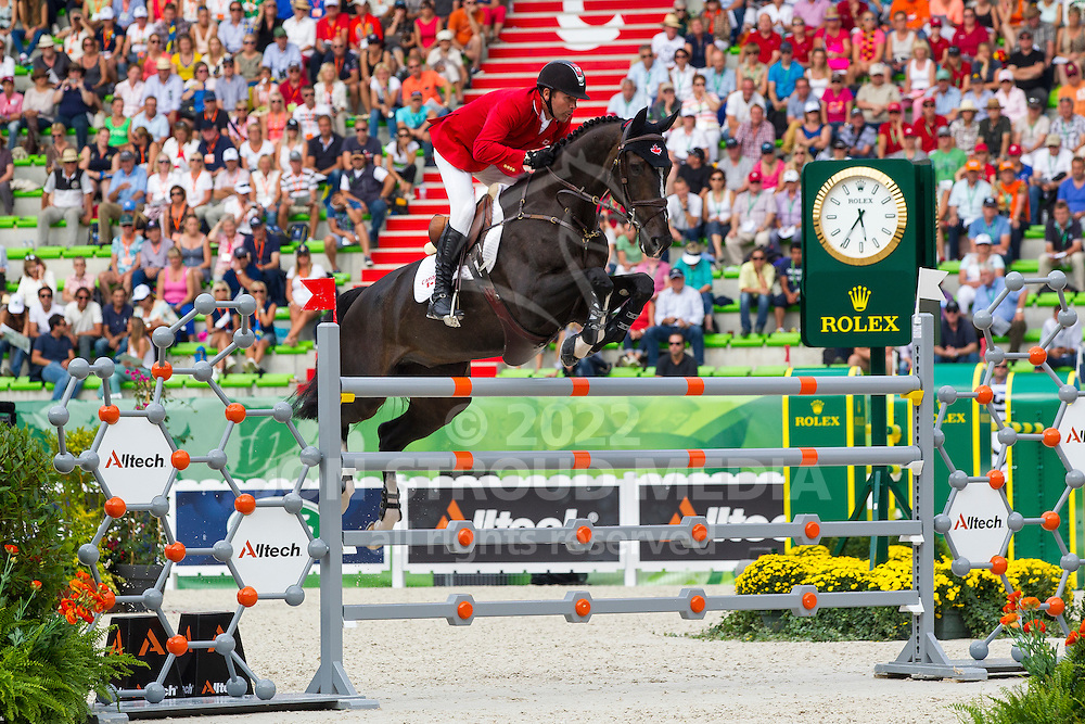Eric Lamaze, (CAN), Zigali PS - World Champions, - Second Round Team Competition - Alltech FEI World Equestrian Games™ 2014 - Normandy, France.<br /> © Hippo Foto Team - Leanjo De Koster<br /> 25/06/14