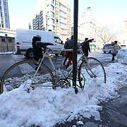 A locked bicycle is seen on the snow covered sidewalk in the Manhattan borough of New York on Thursday, Jan. 23, 2014. A recent snow storm created by a polar vortex, dumped almost a foot of snow in some areas of New York City, followed by bitter cold.The NFL plans on featuring the Super Bowl at MetLife stadium in New Jersey on February 3rd amid growing concerns about more snow and bitter cold arriving just prior to the game.  (AP Photo/Alex Menendez)