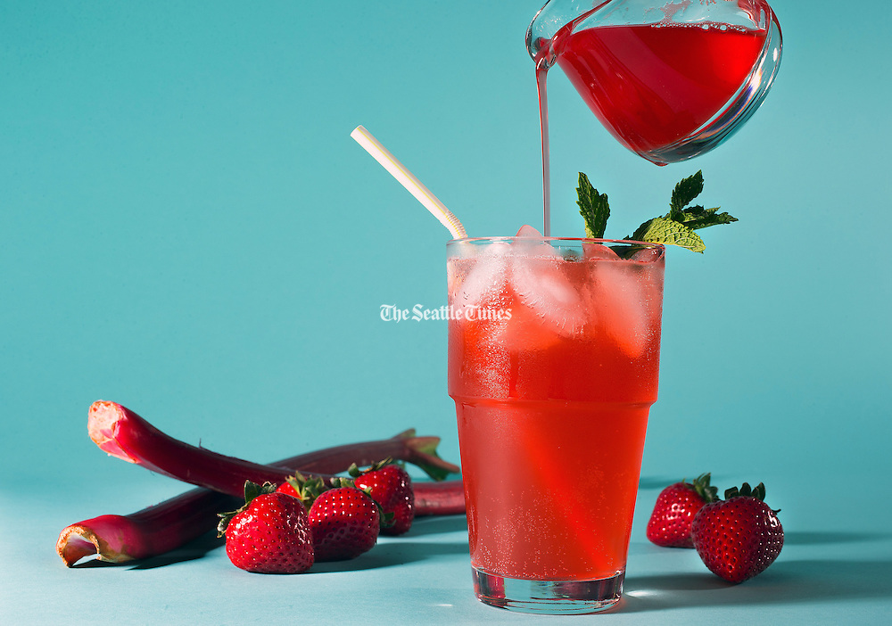 Strawberry-rhubarb soda made at home offers all-natural bright color and flavor.  (John Lok / The Seattle Times)