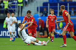 New Zealand's Chris Wood (left) and Russia's Alexander Erokhin battle for the ball