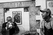 """PM candidate for Liberi e Uguali (Free and Equal) Pietro Grasso eats """"focaccia barese"""" in a local bakery in the old part of Bari. In the background the city patron Saint Nicholas.. Bari 23 February  2018. Christian Mantuano / OneShot"""