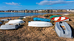 Sailing boats lying in sand dunes in Elie on the East Neuk of Fife, in Scotland, UK