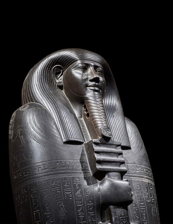 Ancient Egyptian greywacke sarcophagus lid of Ibi - late Period, 26th Dynasty (664-610BC). Egyptian Museum, Turin. black background<br /> <br /> Ibi was overseer of the priests of Thebes and chief steward of Nitocris, Divine Adoratrice of Amon during the reign of Psamtek I. The sarcophagus lid shows his hands emerging from a shroud to grasp the dfed-pillar, which allows him to rise to his feet again after resurrection. The lid weighs more than a ton and is finely sculpted. Despite the hardness of the greywacke stone the sarcophagus is made from, its makers have shown incredible skill creating a sarcophagus with intricate detail and a highly polished finish. .<br /> <br /> If you prefer to buy from our ALAMY PHOTO LIBRARY  Collection visit : https://www.alamy.com/portfolio/paul-williams-funkystock/ancient-egyptian-art-artefacts.html  . Type -   Turin   - into the LOWER SEARCH WITHIN GALLERY box. Refine search by adding background colour, subject etc<br /> <br /> Visit our ANCIENT WORLD PHOTO COLLECTIONS for more photos to download or buy as wall art prints https://funkystock.photoshelter.com/gallery-collection/Ancient-World-Art-Antiquities-Historic-Sites-Pictures-Images-of/C00006u26yqSkDOM