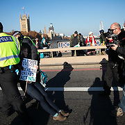 Thousands of Extinction Rebellion activists took over 5 bridges in Central London and blocked them for the day, November 17 2018, Central London, United Kingdom. Lambeth Bridge; a female activist is arrested and dragged away after rufusing to comply with police. Around 11am people on all bridges sat down in the road and blocked traffic from coming through and stayed till late afternoon. The actvists believe that the government is not doing enough to avoid catastrophic climate change and they demand the government take radical action to save future generations and the planet. Many are willing to be arrested peacefully protesting and up to 80 were arrested on the day. Extinction Rebellion is a grass root climate change group started in 2018 and has gained a huge following of people commited to peaceful protests and who ready to be arrested. Their major concern is that the world is facing catastropohic climate change and they want the British government to act now to save future generations.