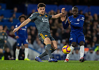 Football - 2018 / 2019 Premier League - Chelsea vs. Leicester City<br /> <br /> Harry Maguire (Leicester City) clears in front of Ngolo Kante (Chelsea FC)  at Stamford Bridge <br /> <br /> COLORSPORT/DANIEL BEARHAM