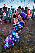 Glastonbury Festival, 2015. Shangri La is a festival of contemporary performing arts held each year within Glastonbury Festival. The theme for the 2015 Shangri La was Protest. Dancing at dawn in front of the Hell stage.