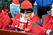 A Forest fan reads his match day programme during the EFL Sky Bet Championship match between Aston Villa and Nottingham Forest at Villa Park, Birmingham, England on 28 November 2018.