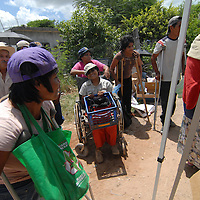 Aug 12, 2010 - Reynosa, Mexico - Satelite Uno is known among the Frank Ferree workers as a place with many elderly and ill residents. A family of four sisters all who have debilitating health issues gather  in line at the distribution point waiting..(Credit Image: © Josh Bachman/ZUMA Press)