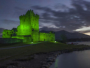 Ross Castle, Killarney, Ireland is illuminated in green for St Patrick's Day.<br /> Photograph: Don MacMonagle